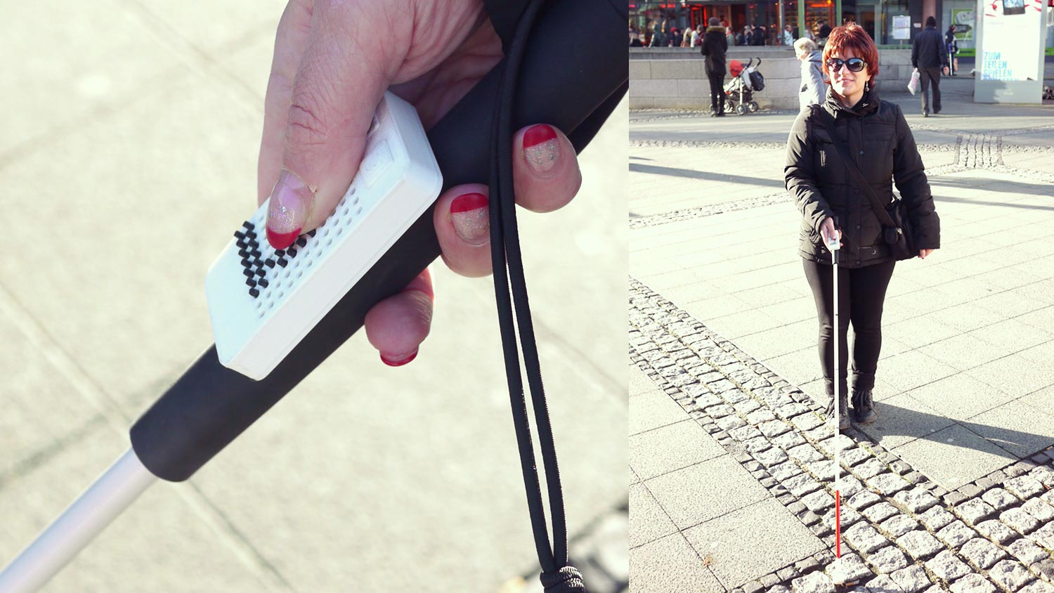Silja Korn testing the prototype on the street with holding a blindman's stick and the interface